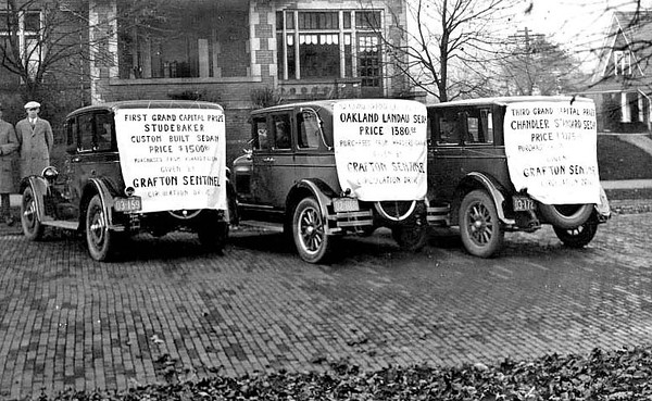 Custom built Studebaker, Oakland Landau Sedan, and a Chandler Standard Sedan, three automobiles given as prizes by the Grafton Sentinel Publishing Company during a circulation drive 1926.
