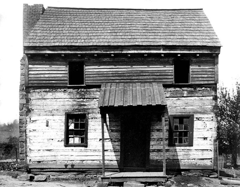 Two story log cabin with covered entrance, the first house in Grafton, W. Va., built in 1811. The first child born in Grafton was born here in 1847.