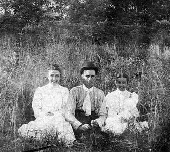Sitting in the tall grass, Ada Enid Haldeman, Arthur C. Thomas and Olivia L. Haldeman 1906