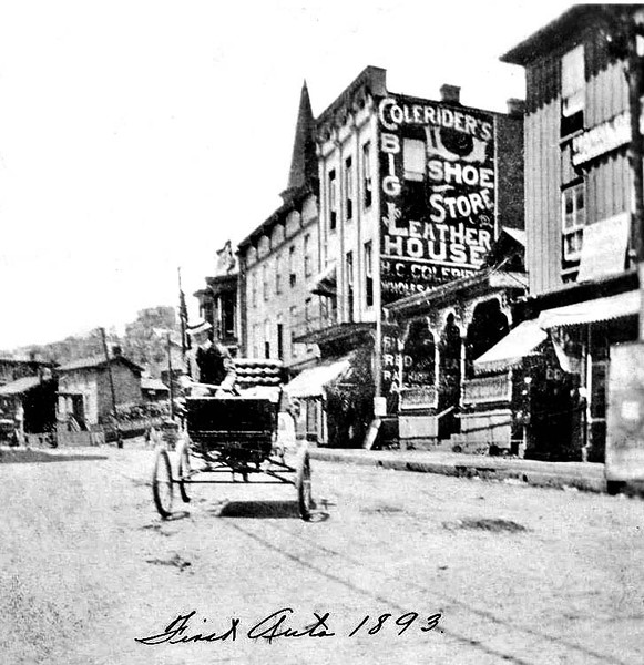 First Automobile in Grafton, W. Va. Driving on Main Street<br /> Date 1893