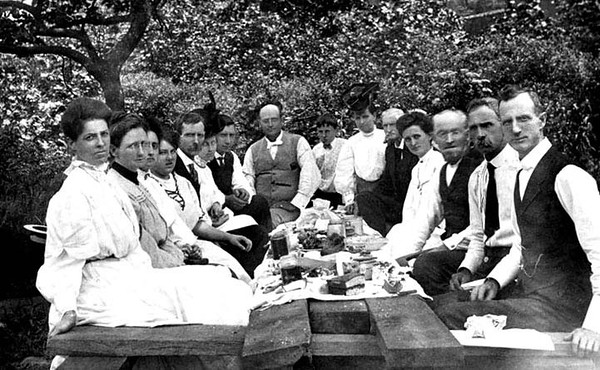 Loar family and others gathered around a table for a picnic, Grafton, W. Va.
