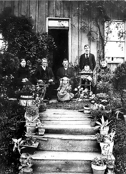 """This was taken in Grafton about 1892 or 1893 (as child in high chair, Lila, was born May 13, 1892). All the people in photo are long deceased.<br /> <br /> I have included the writing on back of photo by Dorcas and John's grand-daughter, Malle Marie Keane (Mrs W P Beveridge). <br />   <br /> Dorcas and John Keane were my great great grandparents. She was born July 12, 1830 , the daughter of Elizabeth Wolcott  and Joshua Hedges King who lived at  White Rocks Farm, now a part of Marion County, I think??. She married John Keane Feb 6, 1851. John was from Ireland. I don't know his exact date of birth, but according to the 1850 census of Grafton, he was born in 1821 or 1822. He died in Grafton on  Dec 10, 1902. Dorcas died in Grafton on  Jan 6, 1899.<br /> <br /> Also in picture are 2 of their 6 sons; John, who never married and Francis Marion Keane, """"Frank"""". Frank's wife, lda Virginia Morgan, the daughter of William H Morgan. <br /> <br /> The two children are daughters Lila Clair (Mrs James Mantz) and Loar Lee (Mrs Leslie Jonathan Loar), <br /> They had 2 other children not in photo, a son, John, who died as an infant and their oldest daughter, Lena Dale, she died at 14. <br /> <br /> Frank Keane was born in Grafton March 22, 1861, and married  April 20, 1884. Frank and Ella lived at 310 Thayer Ave in Grafton."""