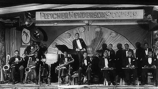 Fletcher Henderson Stompers pose with their instruments on stage Grafton, WV 1926.