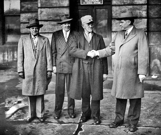 Business Men Outside the Western Union Telegraph and Cable Office, Grafton, W.Va.