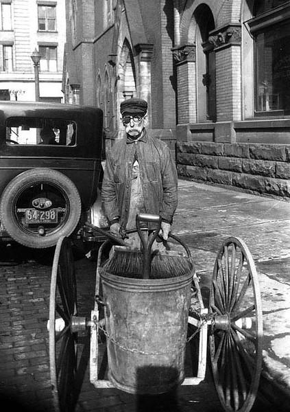A street cleaner with his equipment in Grafton, West Virginia.