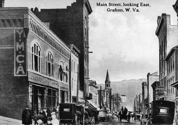 Postcard of buildings and carriages on Main Street looking East in Grafton, Taylor County, West Virginia.