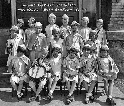 Members of the Juvenile Symphony Orchestra, First Grade, in South Grafton School, Grafton, West Virginia, pose with their instruments for a group portrait.
