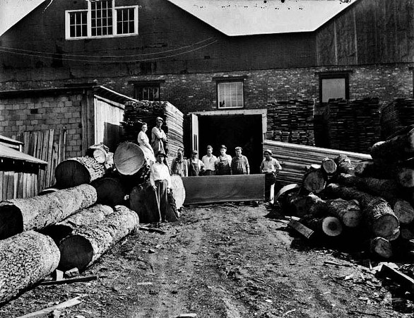 Employees outside the Lumber Yard (Woodyards) on West Main Street (Fetterman) in Grafton, West Virginia.