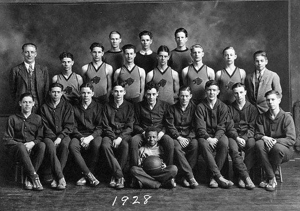 Members of a Boys Basketball team pose for a group portrait, Grafton, WV 1928.