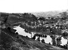 Distant View of a River and Houses Near Grafton, Taylor County, W. Va.<br /> Date ca. 1890