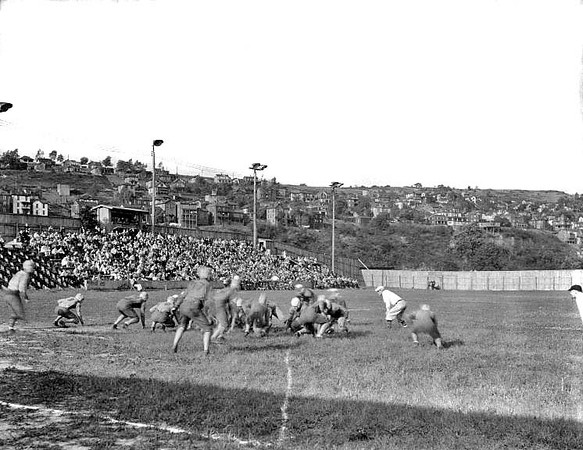 A football game in progress at the field on Riverside Drive Grafton, WV 1928.