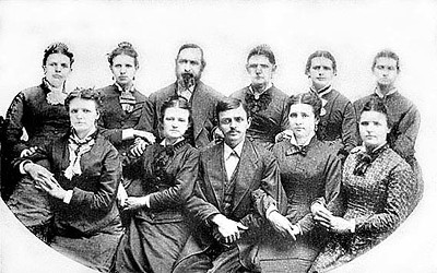 Front Row: Bertie Colerider, Virginia Colerider, Henry Clay Colerider (15), Sallie (Sally) Colerider, Flora Colerider; Back Row: Maggie (Margaret) Colerider, Mary Colerider, Edward Jackson Colerider, Jemima Reger, Lum (Winifred) Colerider, and Ellen Colerider.<br /> In the 1880 Census for Taylor County, West Virginia, Edward is 62 and a boot and shoe maker. His birth place is listed as Virginia. His father's birthplace is Frankfort, Germany and his mother's birthplace is Virginia. Jemima is 53 and keeping house. She is listed as being born in Virginia, as were both her parents. Alvena is 22, Sallie is 21, Flora is 19. There are two boarders living at the home, Albert Graham 27 and Thomas W. Davis 27. Just below Edward's household on the census is Henry C. Colerider, his son. Henry is the head of a household and 25 years old. He is a shoe maker. His wife, Alma, 22, is keeping house. Albert Kelly, 18, is an apprentice and works in the shoe shop.