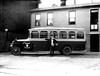 Young Man Standing Next to a Bus on Main Street, Grafton, W. Va.<br /> Date 1927