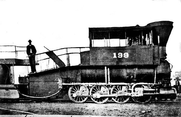 Man stands atop the first type of B&O engine built circa 1850 - Grafton, WV.