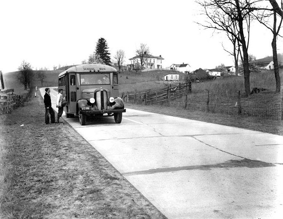 Children Getting on School Bus on Rt 50 west of Grafton, W. Va.