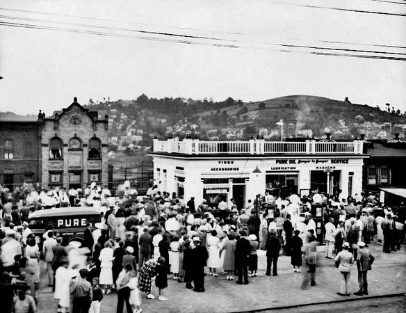 A large crowd outside the Pure Oil Gas Station in Grafton, West Virginia.