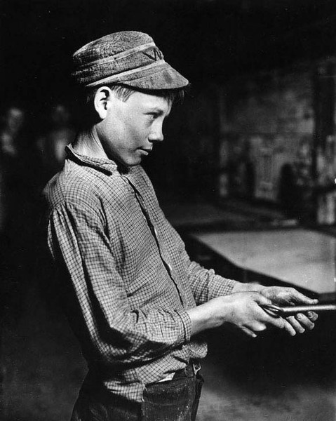 Carrying-in Boy at the Lehr, (15 years old) Glass Works, Grafton, W. Va. Has worked for several years. Works nine hours. Day shift one week, night shift next week. Gets $1.25 per day. Location: Grafton, West Virginia. Date: 1908 October. Child labour pic by Lewis Hine.