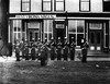 Soldiers standing in front of the West Virginia Argus building in Grafton, West Virginia.