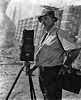 Mr. Albright, photographer, in Grafton, W. Va. standing with his camera