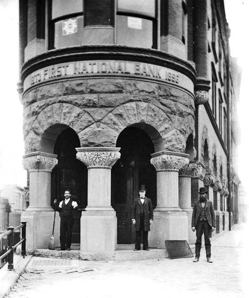 ca. 1890 - Three men standing in the entrance of the First National Bank in Grafton, W. Va.