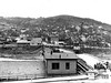 Cranes sit near St. Marys bridge that is being demolished in Grafton, West Virginia. Ca. 1960's.