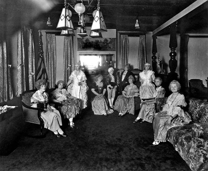 Ladies Aid Society members in costume sit for a group portrait at St. Andrew's Methodist Episcopal Church in Grafton, West Virginia 1922.
