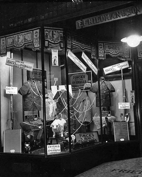 Front entrance and window display of Friedman & Son Clothing Store on Main Street in Grafton, WV 1928.