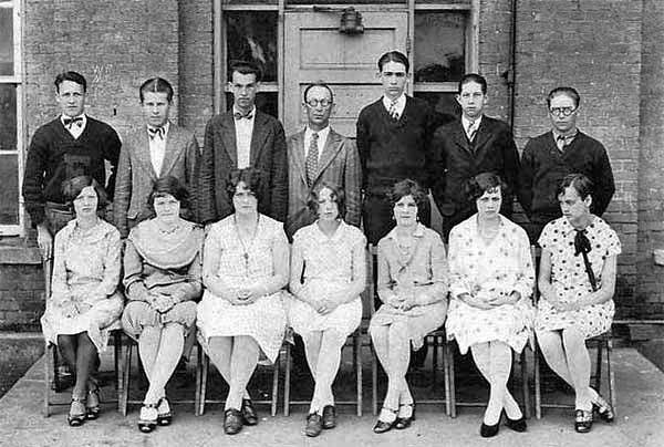 Front Row L-R: Edith Menear, Velma Marks, Flora Reed, Ruby ?, Ann Flaherty, Harriet Dawson, Nancy ?  <br /> Back Row L-R: Lyle Menear, Paul Kopso, Joe ?, ? Rogers (Teacher), ? Radcliffe, Bob Phelps, Albert Johnson