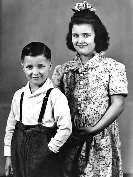 A young boy poses with an older girl in this photograph Grafton, WV