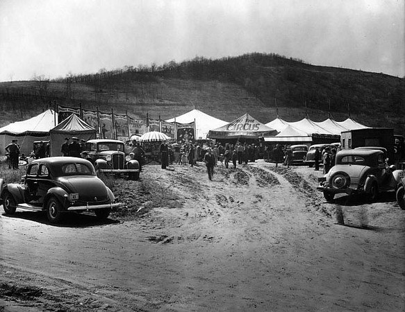 People gathered near tents and booths of the Wallace Brothers Circus at the Old Fairground on Riverside Drive in Grafton, West Virginia 1920.