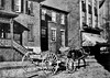 'One of Grafton's Quaint Characters,' George Timmons driving his horse and wagon down a street in Grafton, W. Va.