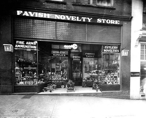 Front entrance and window displays of Favish Novelty Store in Grafton, W. Va. Children's riding toys at the entrance