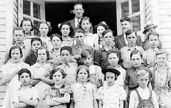 Wendel School, Taylor County...1938-39, front row l-r 1st Jimmy Carusa, 4th Ruth Regar; 2nd row l-r 5th Jack Taylor, 7th ? McCoy; 3rd row l-r 2nd Sandy Popalardo, 4th ? Heavener, 5th Frances Hess, 6th ? Marteny, 7th John Knotts Jr.; back row l-r 1st Helen Davis, 2nd Leoma Green, 3rd Rosie Bevelock, 5th ? McCord, 6th ? McCord