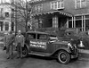 "Two men standing beside car that has a sign on it that reads ""Patronize the B.& O. and put men to work."" Grafton, W. Va."
