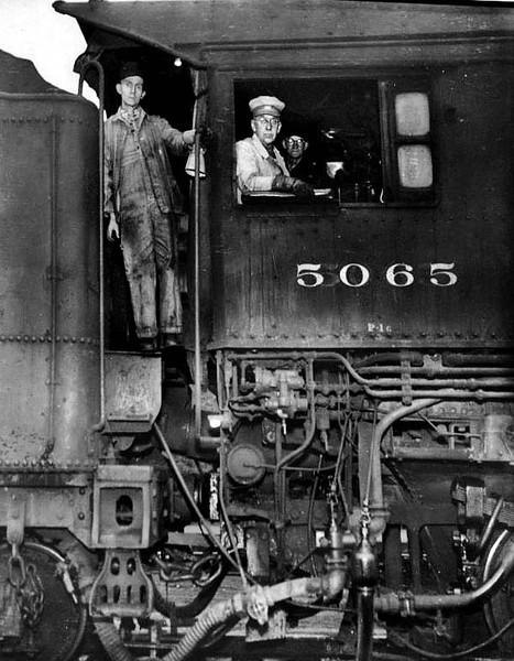 Three men in the cabin of a locomotive engine no. 5065. Grafton, W. Va.