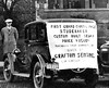 Man stands behind a custom built Studebaker, the First Grand Capital Prize Given by the Grafton Sentinel during a circulation drive 1926.
