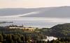 Nes sett frå Bleiken. (August evening view over Randsfjorden.)