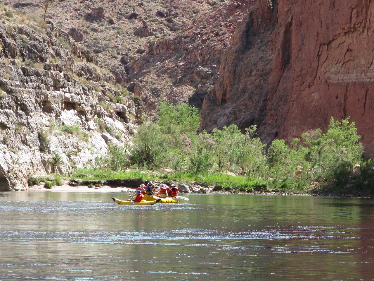 A kayak and raft drifting in Marble Canyon.