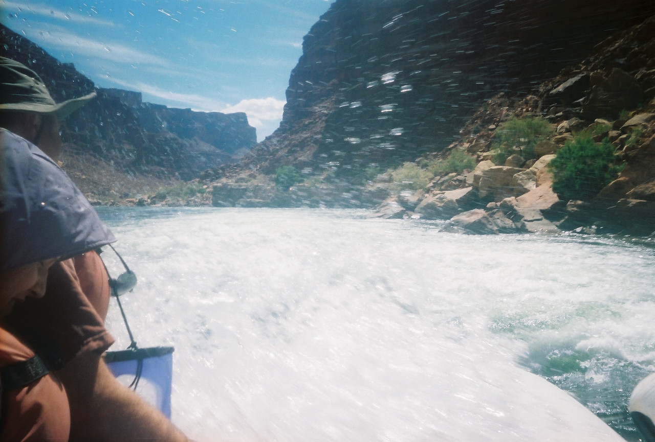 23 Mile Rapid, rated 2-4, drop 5 feet.  Hang on Dariusz!