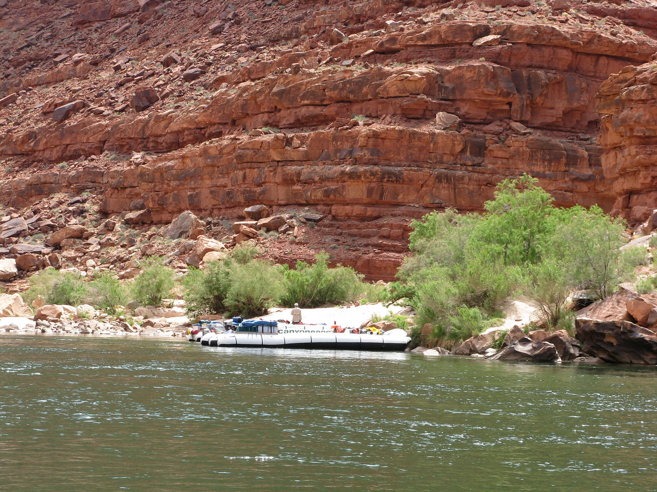 The rafts carrying guests on the 7-day, full canyon trip have stopped further down stream for lunch. We pass them while the rafts are tied to shore.