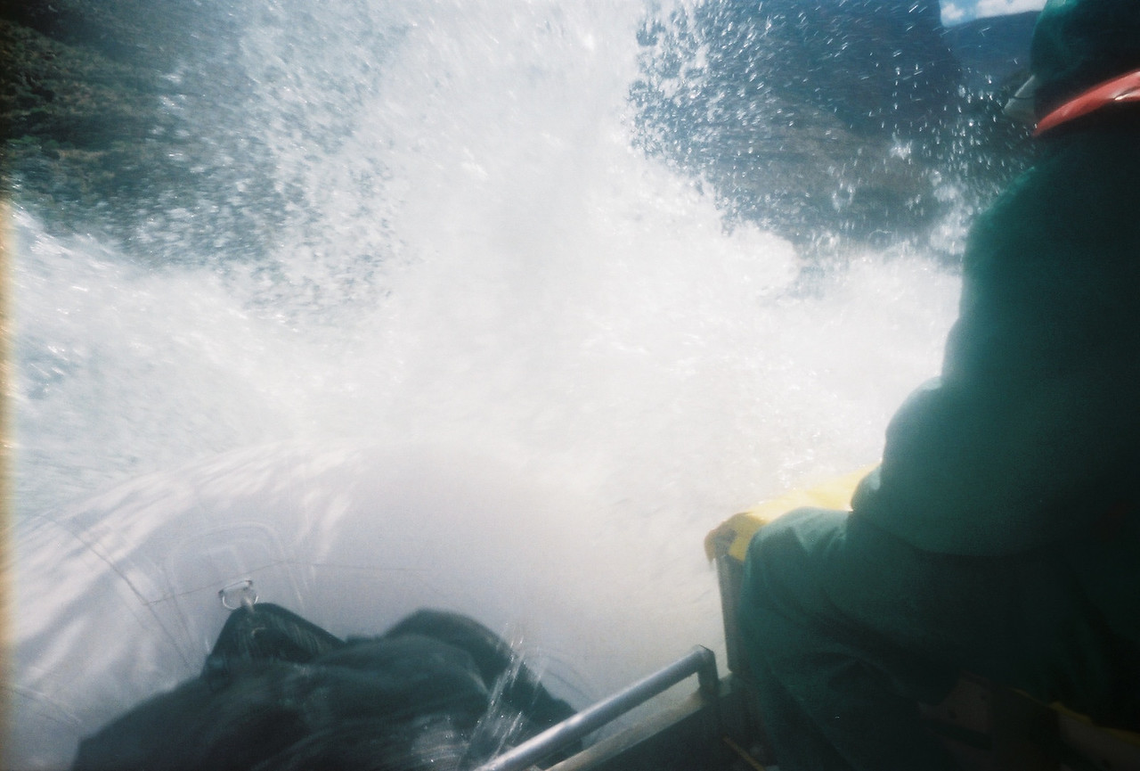 Mile 24: Georgie Rapid, rated 3-7, drop 4 feet.  The bow of the boat is under the crashing wave of water.