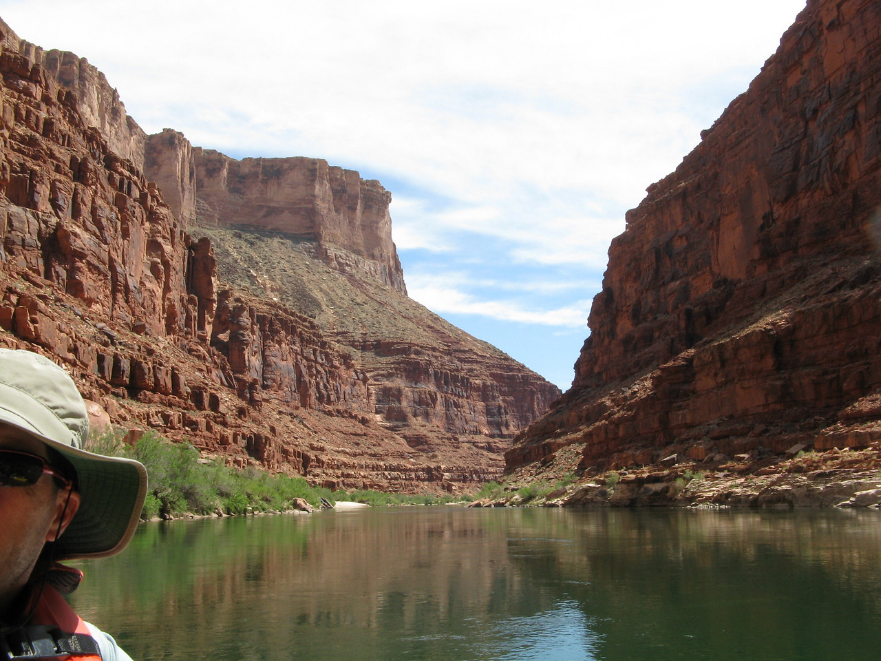 About mile 19: As we continue to head downstream in Marble Canyon, the water is calm and flat with some reflections on the water.