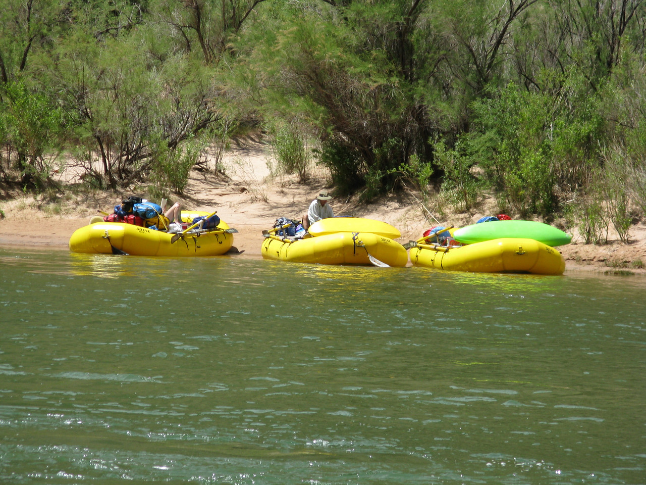 Yellow rafts on the beach.