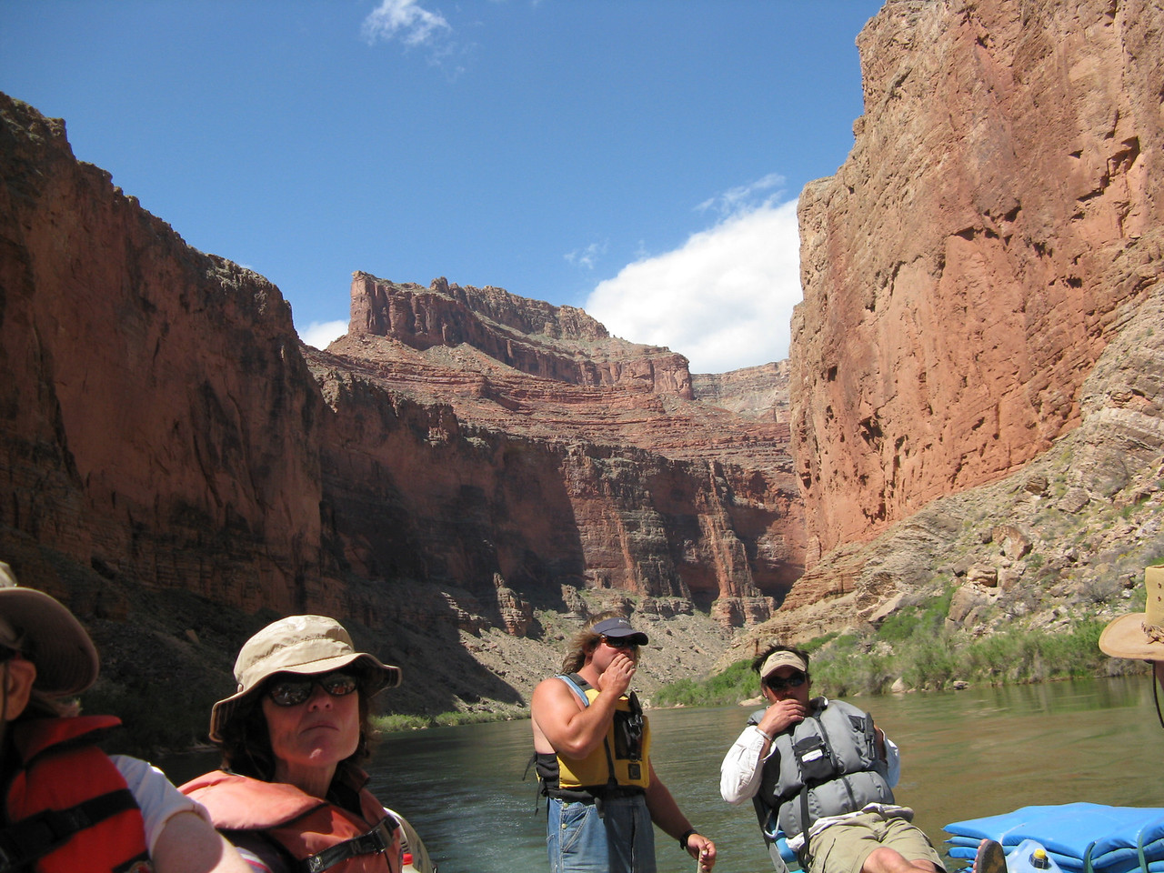 An upstream view with Jake at the tiller.