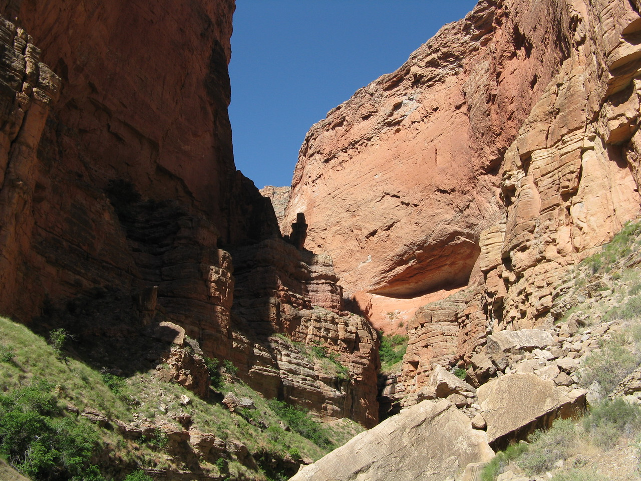 We climbed around and over huge boulders in the difficult climb up the side canyon.
