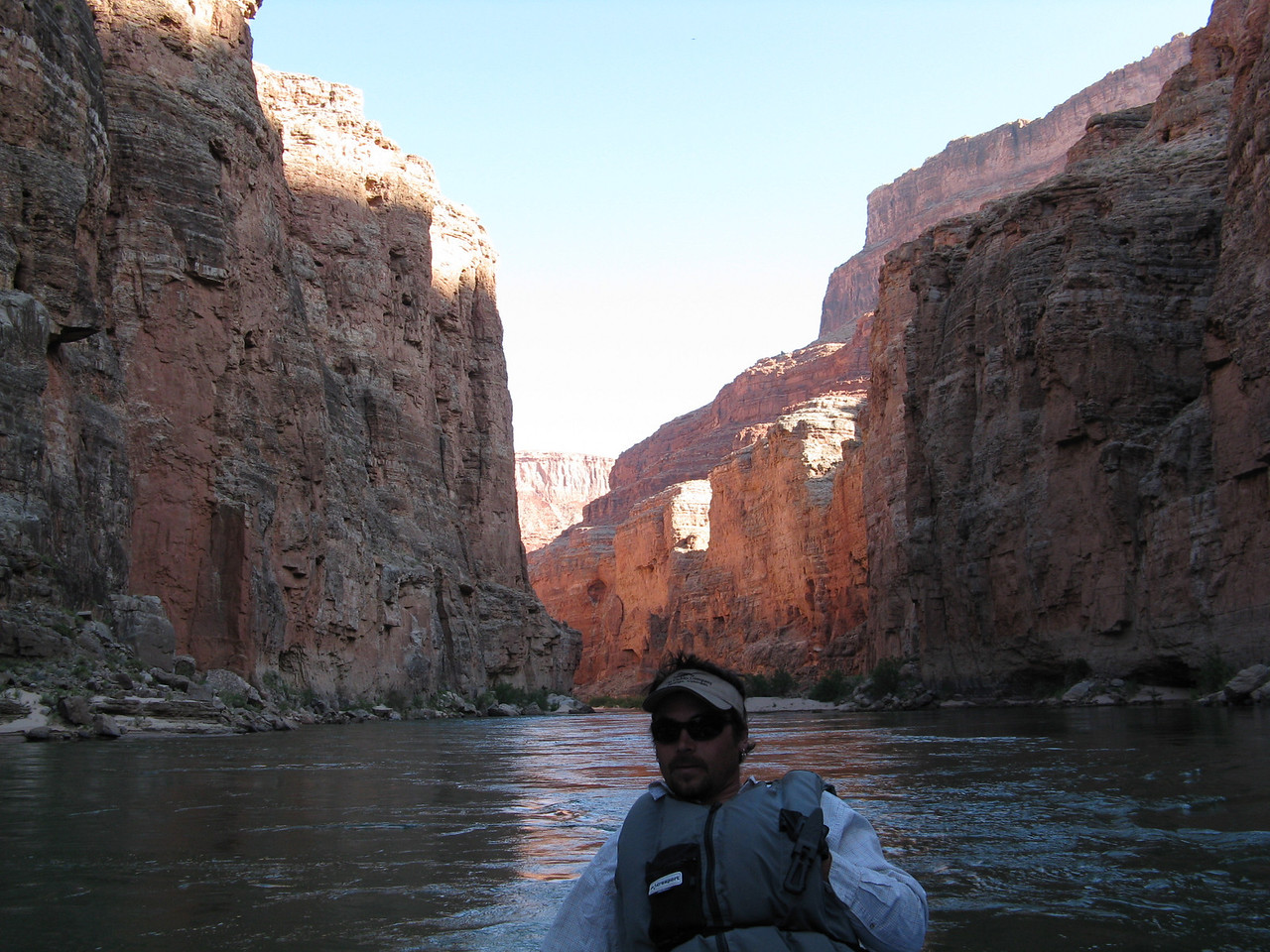 An upstream view with Brandon at the tiller on the outboard.