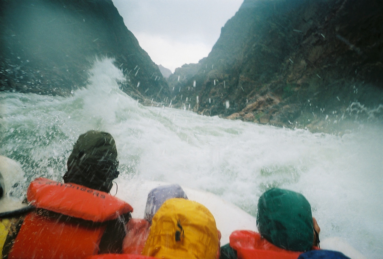 Huge waves loom above our heads as the boat dives into a trough between the waves.