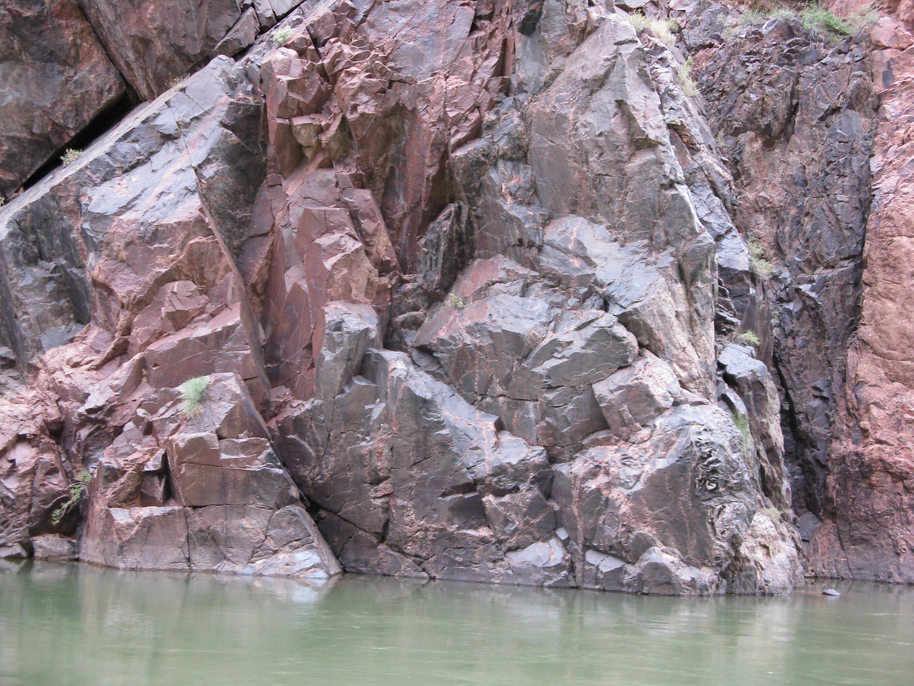 There are no apparent patterns in this metamorphic rock, compared to the neat horizontal layers of sedimentary rock upriver in Marble Canyon.