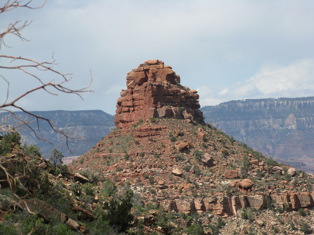 Looking northwest to the butte in the Supai Group of rocks.  This rock formation is named The Battleship.
