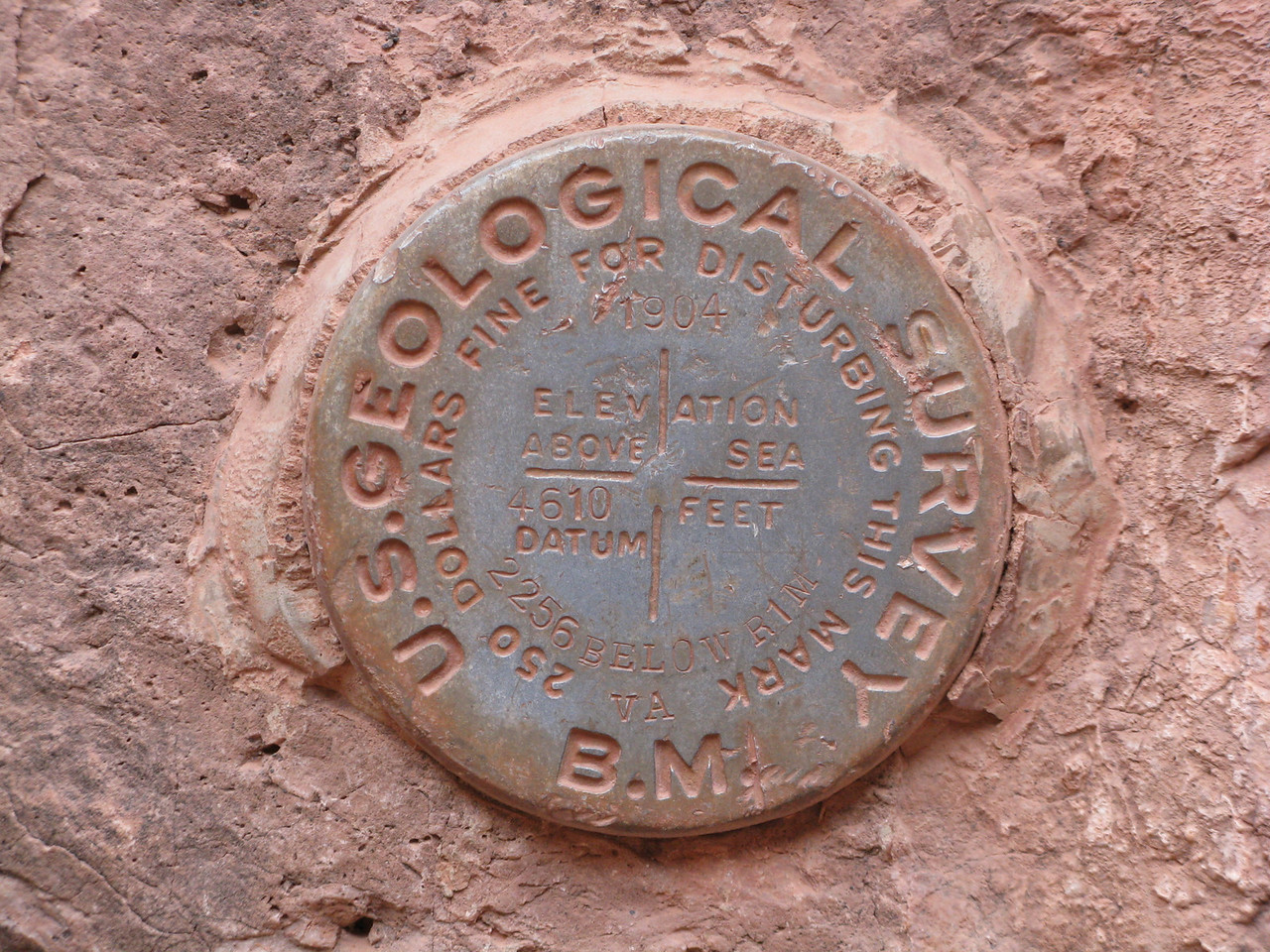 US Geological survey marker.  4610 feet above sea level.  2256 feet below the South Rim.  The marker is placed at a point about half way up in elevation from the river to the rim.